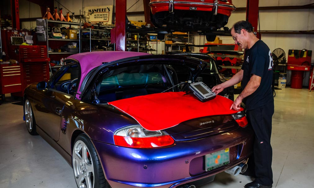Computer diagnosis being performed on a Porsche | F1 Imports & Exotics Luxury Car Service Center & Repairs Southwest Florida