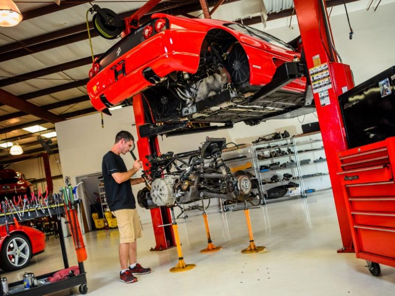 Eric Krukow, owner and operator of F1 Imports & Exotics, preforming a Ferrari Repair | Luxury, Highline, Exotic car automotive service center and repairs Southwest Florida