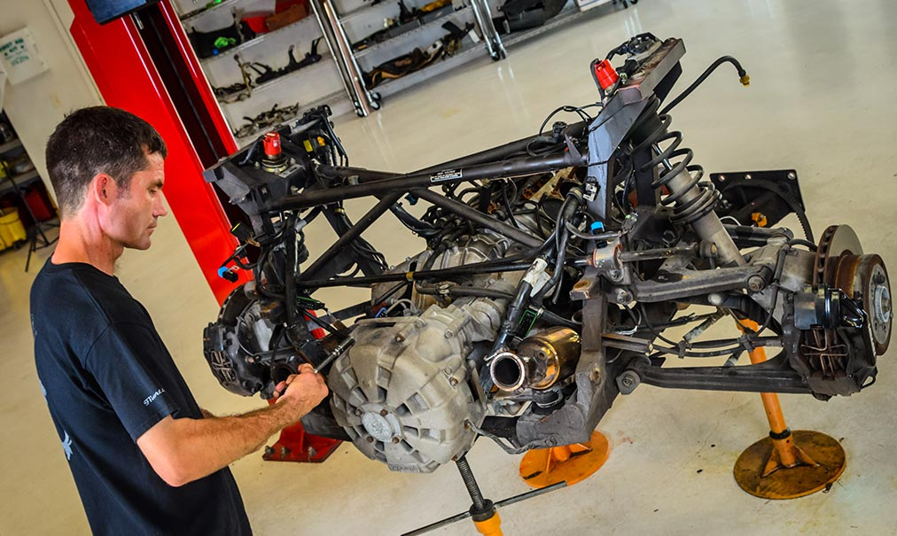 Eric Krukow, owner and operator of F1 Imports & Exotics, servicing a Ferrari Repair | Exotic Car and Luxury Automotive Service Center Naples, Florida