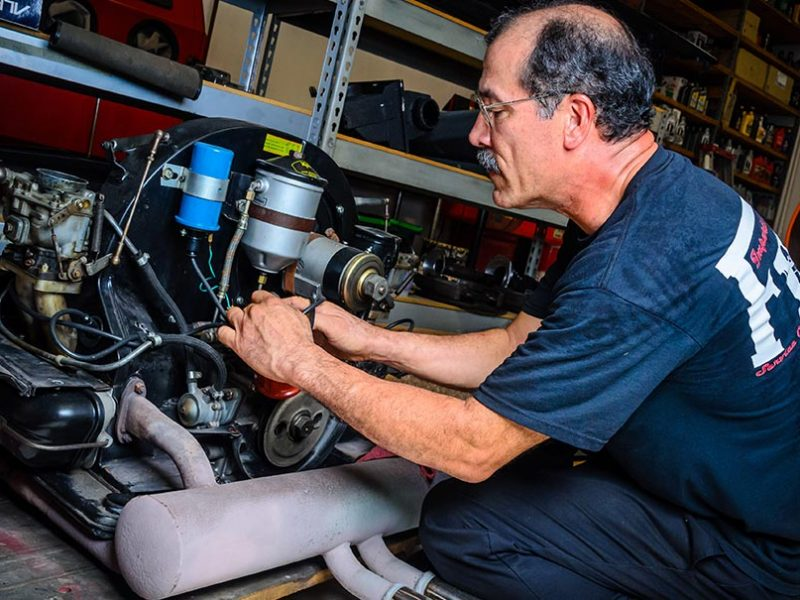 F1 Imports & Exotics master technician servicing a motor | Luxury, Highline and Exotic Car Automotive Services and Repairs Ferrari Repair Naples Florida