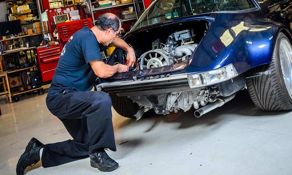 F1 Imports & Exotics master technician performing a vehicle service on a Porsche | Exotic Car and Luxury Automotive Service Center Southwest Florida